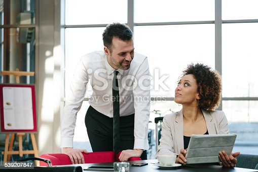 istock Two business people using a digital tablet in the restaurant 539207847