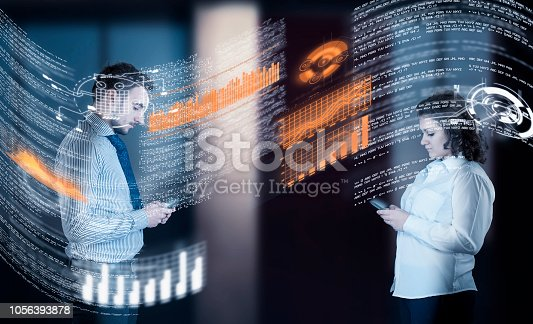 istock Two business people using smartphones and sharing data information on a futuristic interface. 1056393878