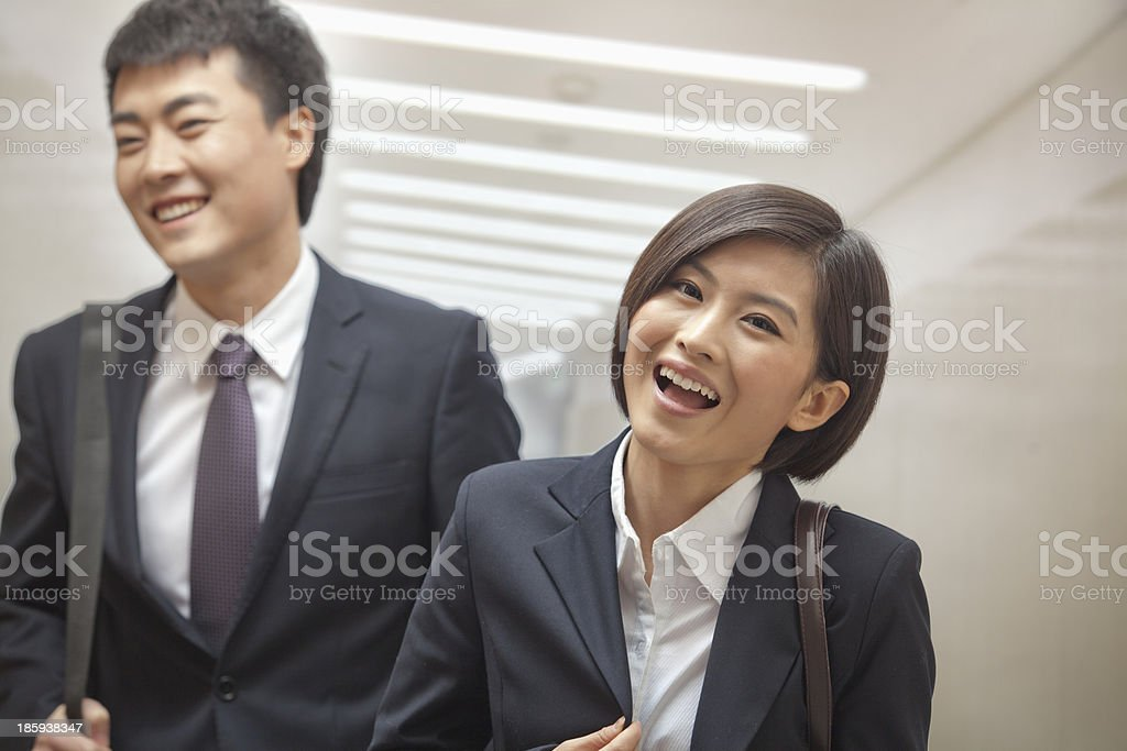 Two Business People Walking Together royalty-free stock photo