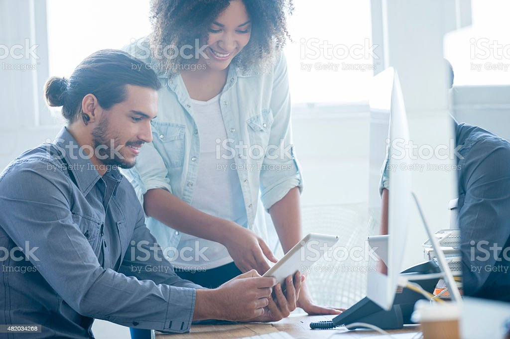 Two Business people working on digital tablet. - Royalty-free 2015 Stock Photo