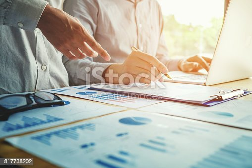 istock Two Business people working together on laptop meeting with technology 817738202