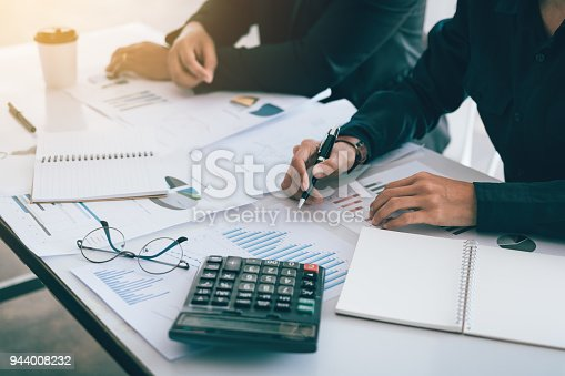885956164istockphoto Two business people worry about work in office. 944008232