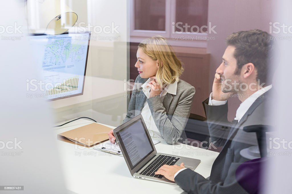 Two business peoples working together in meeting room royalty-free stock photo