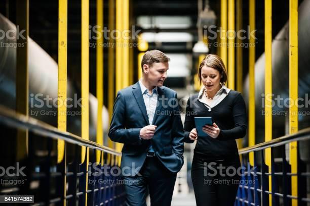 Two business person walking a dark factory hallway picture id841574382?b=1&k=6&m=841574382&s=612x612&h=rd5k1xrl8d0 gu7e hy lj9vg4kjurdhgeuifesw9x8=