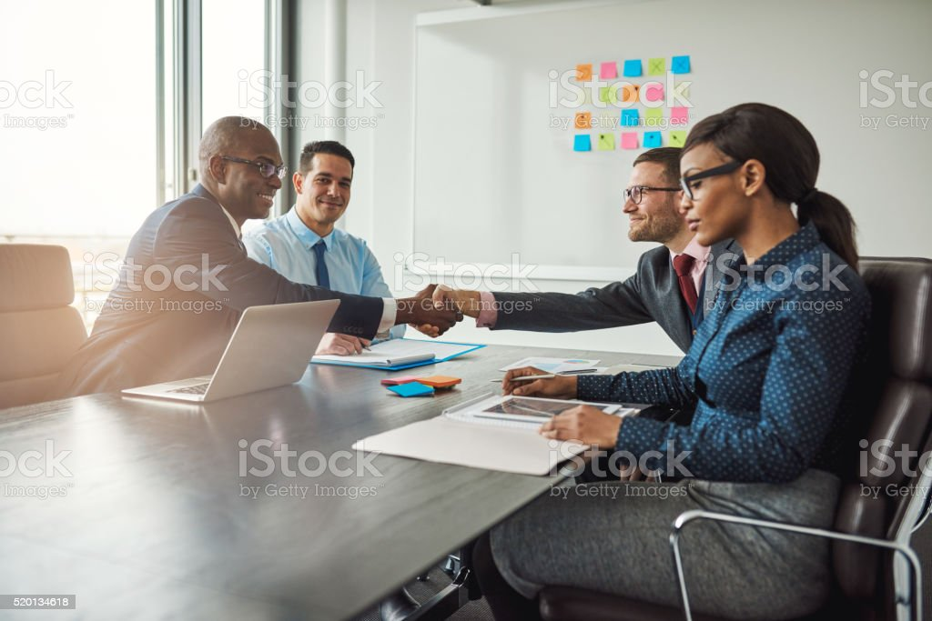 Two business teams reaching an agreement stock photo
