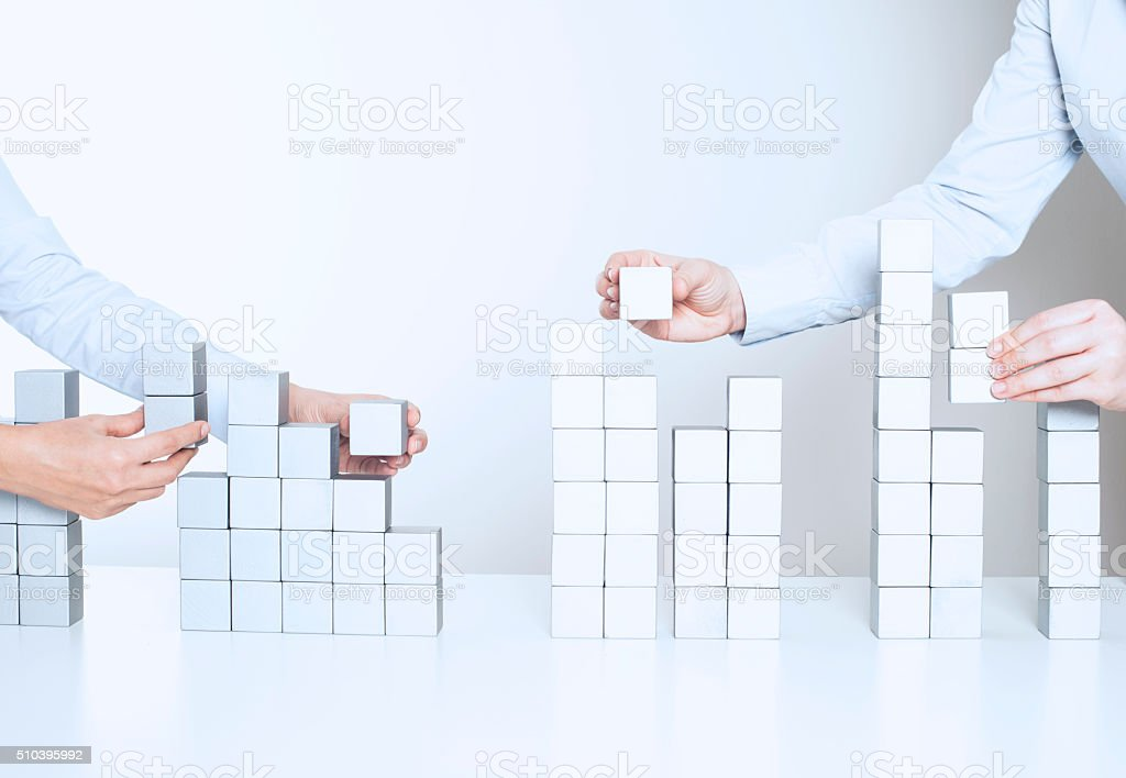 Two business woman building a project stock photo