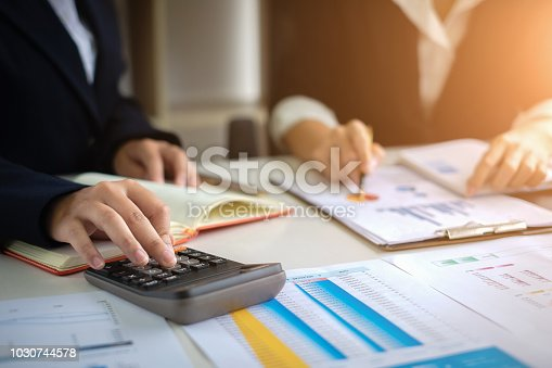 istock Two Business woman or Accountant working with calculator for investigation of corruption account. Anti Bribery concept. 1030744578