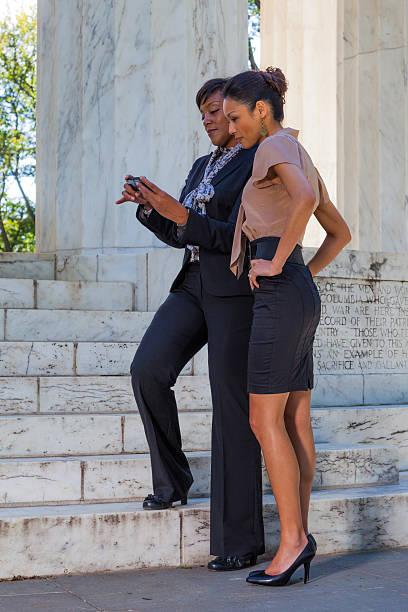 two business women in washington, dc - carolinemaryan stock pictures, royalty-free photos & images