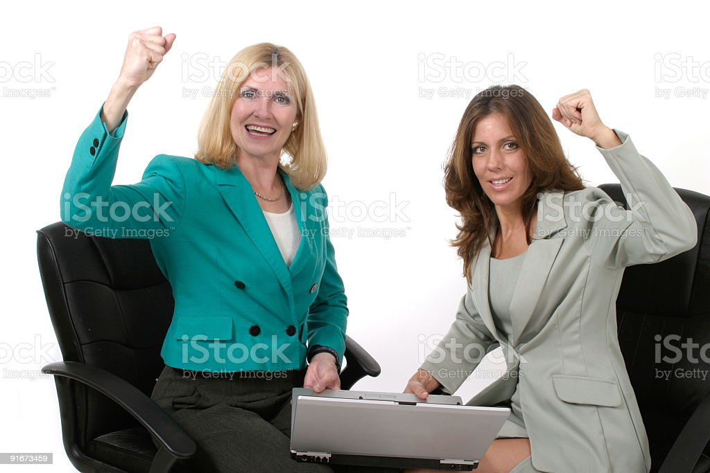 Two Business Women Working On Laptop royalty-free stock photo