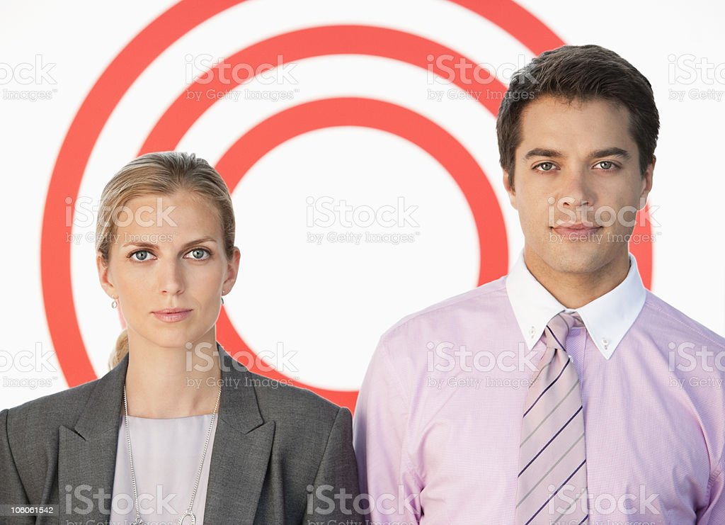 Two business workers standing against bull's-eye royalty-free stock photo