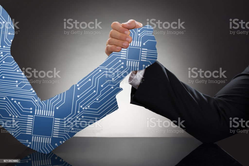 Two Businessman Arm Wrestling stock photo