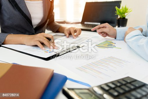858031152istockphoto Two businessman colleagues discussing plan financial graph data on office table with laptop. Concept business and finance 845728014