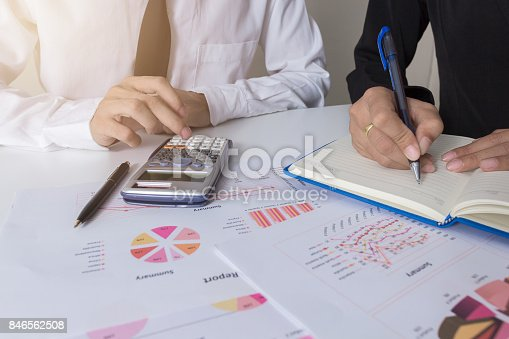 858031152istockphoto Two businessman colleagues discussing plan with financial graph data on office table with laptop, Concept co working, Business meeting 846562508