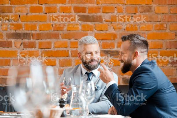 Two Businessman Having A Successful Meeting At Restaurant Stock Photo - Download Image Now