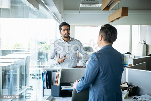 istock Two businessman in serious discussion 960645016