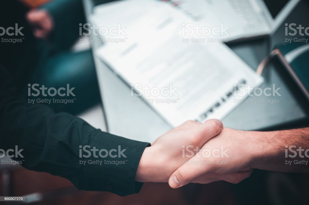 Two businessman making a contract stock photo