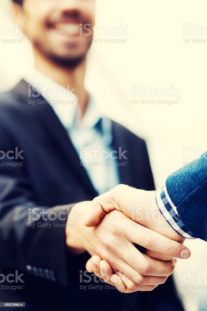 Two businessman shaking hands stock photo