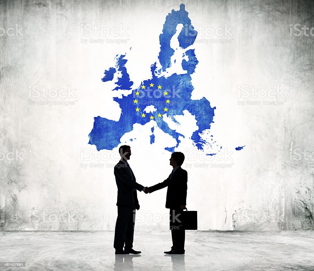 Two Businessman Shaking Hands With EU stock photo