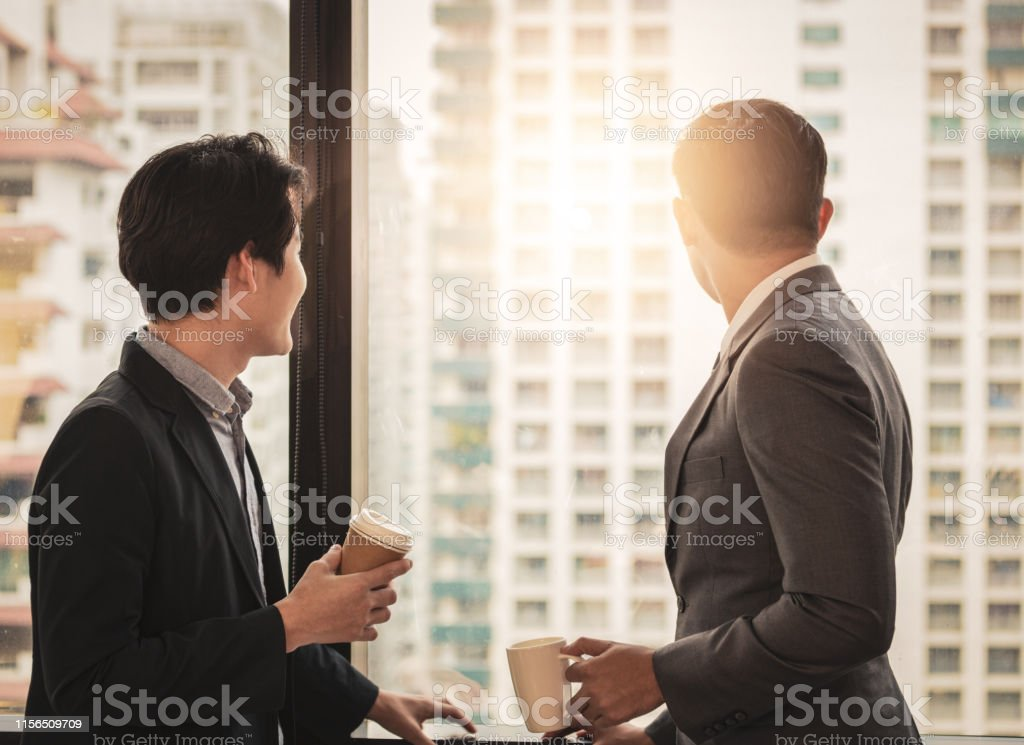 Businessman standing and talking office together