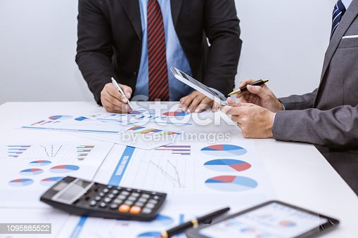 istock Two businessman using tablet. businessman meeting together about business, finance and investment. 1095885522