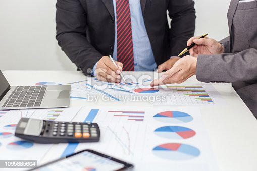istock Two businessman using tablet. businessman meeting together about business, finance and investment. 1095885604