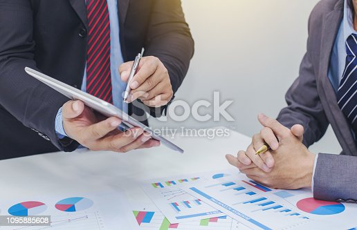 istock Two businessman using tablet. businessman meeting together about business, finance and investment. 1095885608