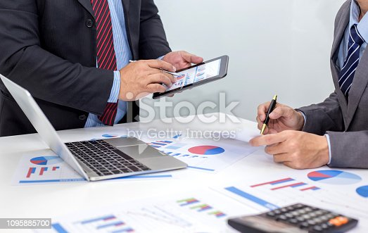 istock Two businessman using tablet. businessman meeting together about business, finance and investment. 1095885700
