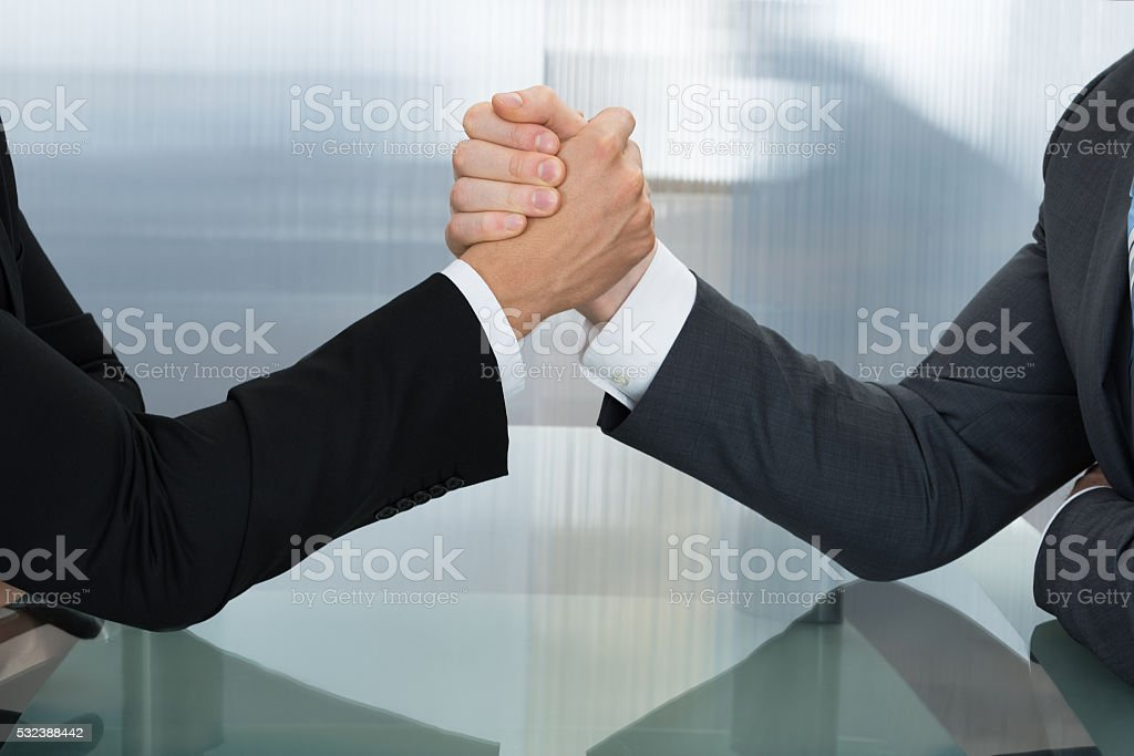 Two Businessman Wrestling stock photo