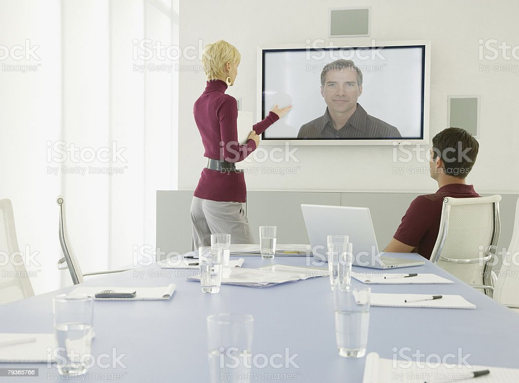 Two Businessmen and businesswoman having a video conference 免版稅 stock photo