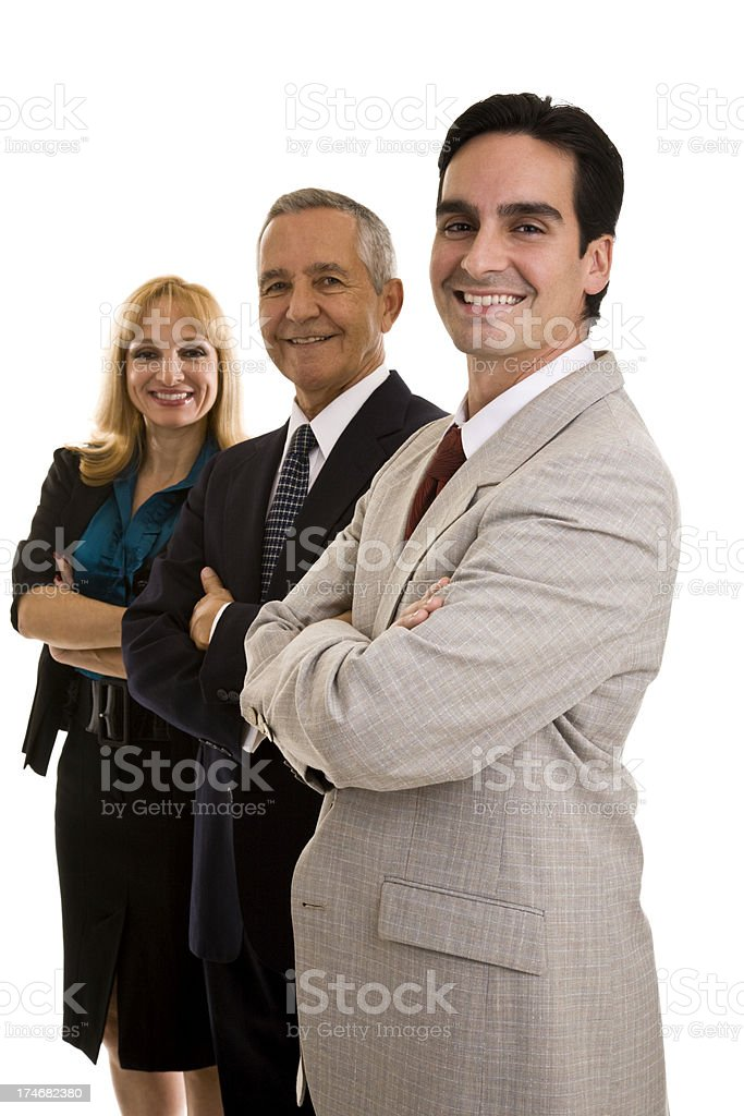 Two businessmen and one businesswoman in a row arms crossed royalty-free stock photo
