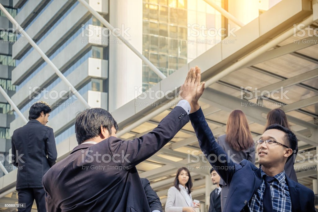 Two businessmen are happy to work together and touch the hands. When the work is successful stock photo