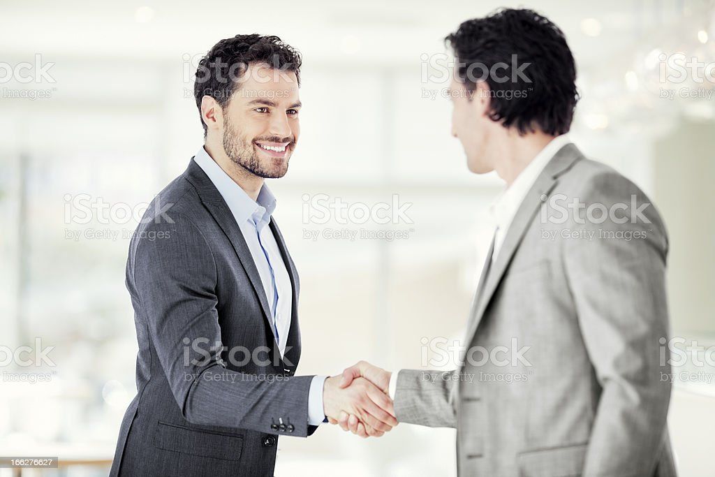 Two businessmen are shaking hands royalty-free stock photo