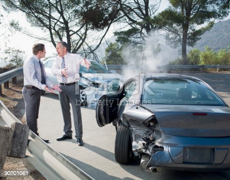 1047083324 istock photo Two businessmen arguing about damaged cars 90201061