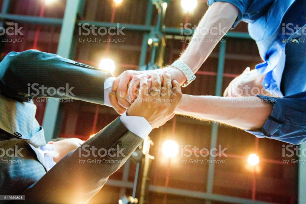 Two businessmen double shaking hands from below stock photo