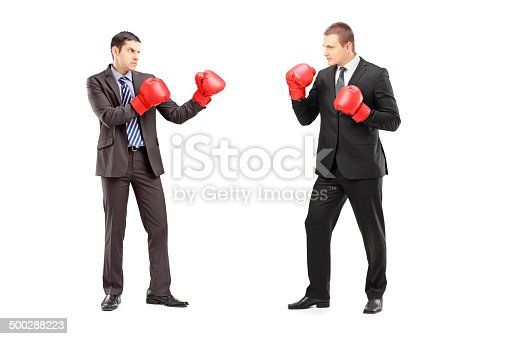 istock Two businessmen having a fight with boxing gloves 500288223