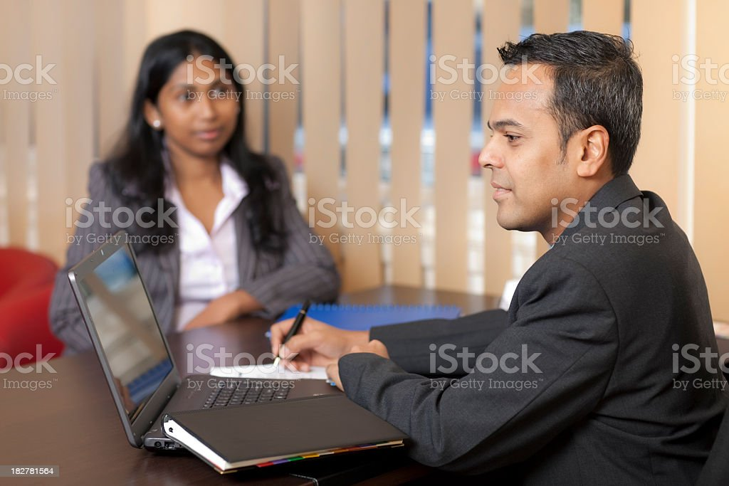 Two businessmen holding a meeting royalty-free stock photo