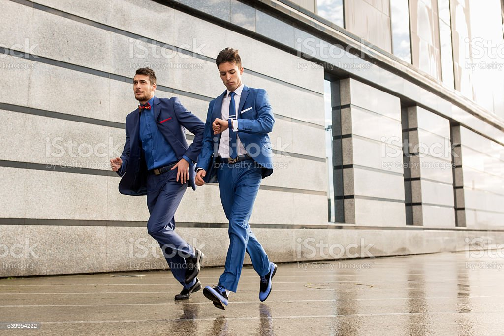 Two businessmen in a hurry on the street. stock photo