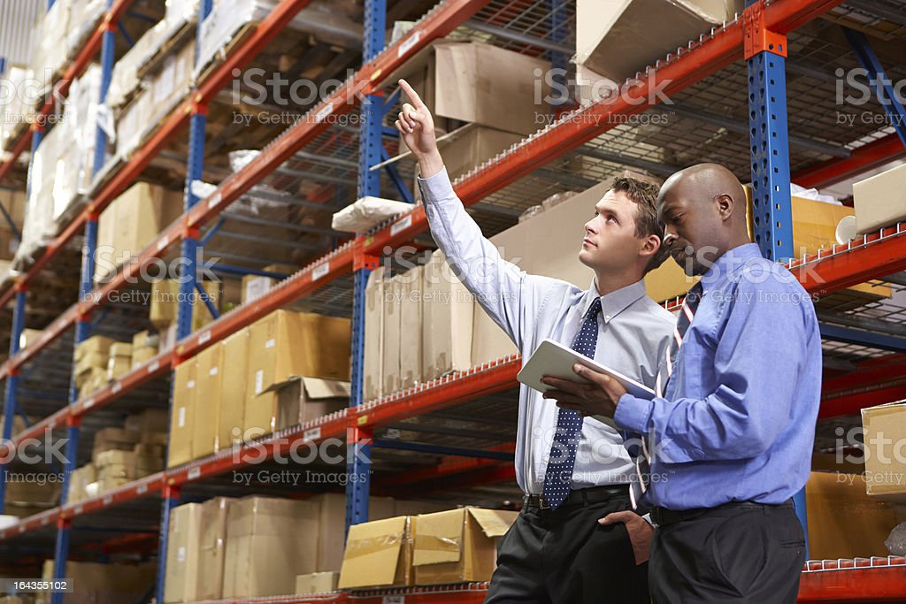 Two Businessmen In Warehouse stock photo