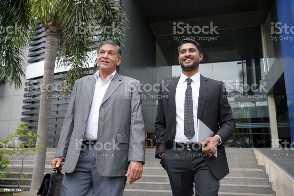 Two Businessmen Leaving Work Low Angle View Stock Photo & More Pictures of  20-29 Years