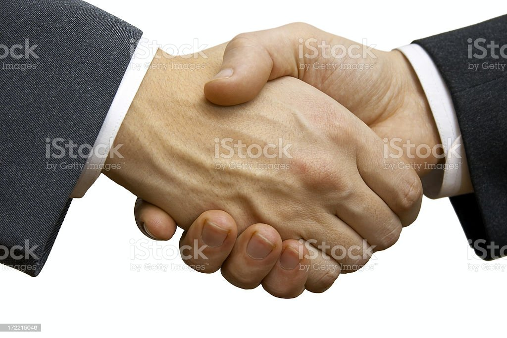 Two businessmen making deal and shaking hands in agreement royalty-free stock photo