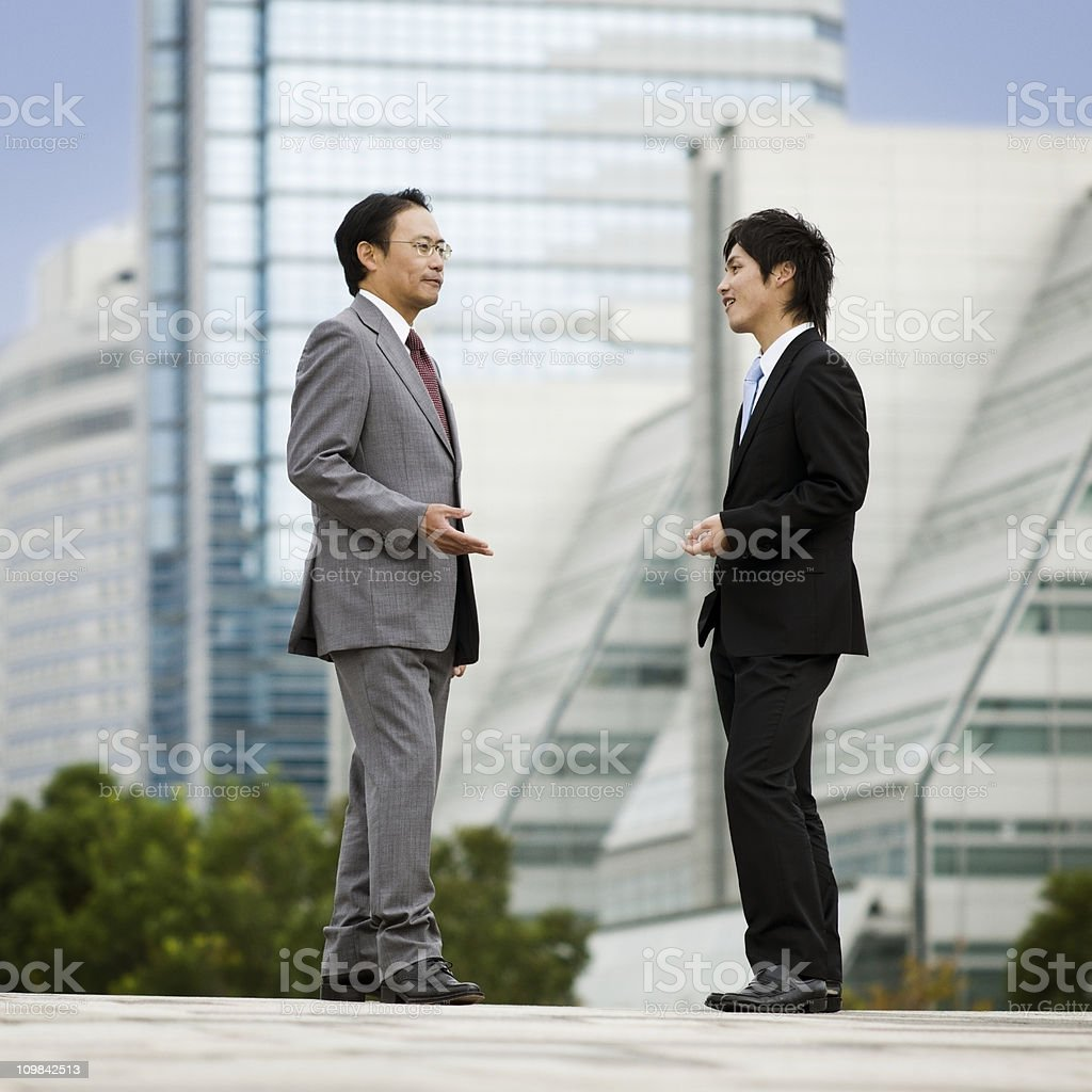 Two Businessmen Meeting Outdoors royalty-free stock photo