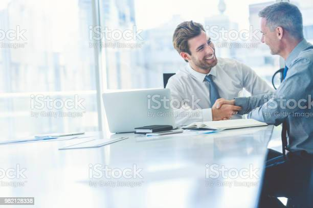 Two businessmen meeting with technology picture id982128338?b=1&k=6&m=982128338&s=612x612&h=m4z cdq6wgkem9ev5l97hziir2mgamyjx qtrfhww1g=
