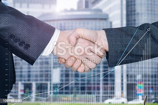 istock Two businessmen partners are shaking hands. 1097993660
