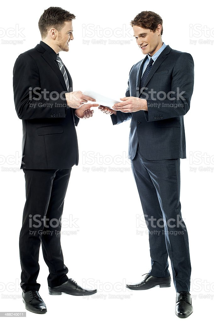 Two businessmen preparing a deal stock photo
