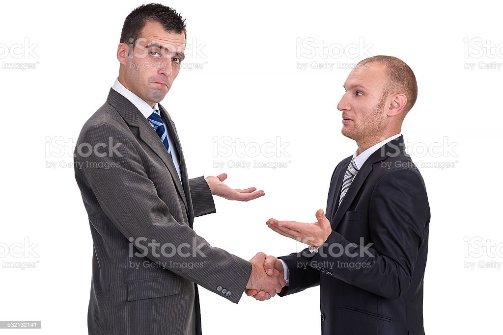 Two businessmen rejecting the responsibility and absolving thems stock photo