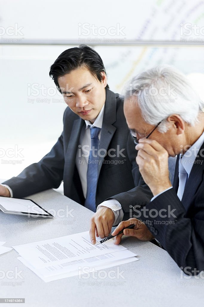 Two businessmen reviewing contract documents royalty-free stock photo