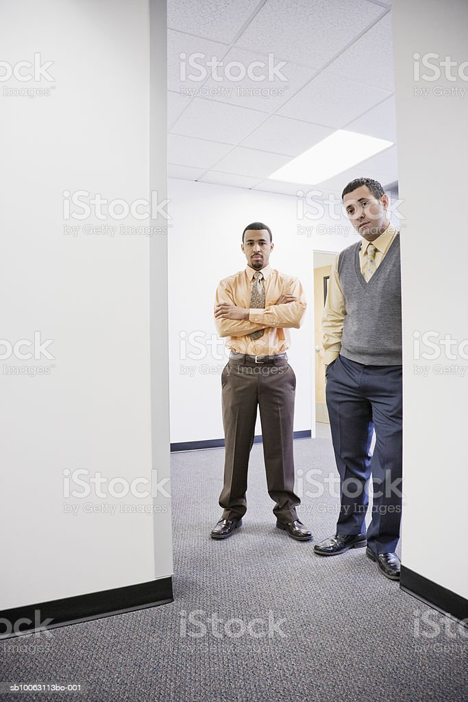 Two businessmen standing at office door foto de stock royalty-free