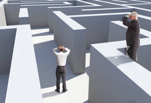 two businessmen standing in maze - lost stock photos and pictures