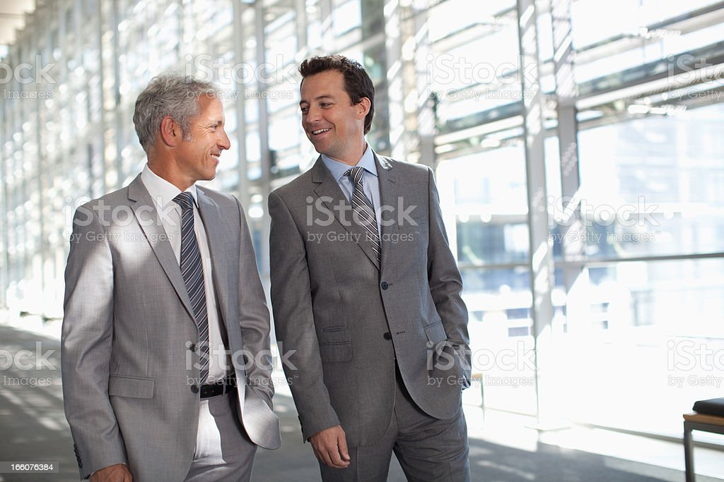 Two businessmen talking in modern lobby royalty-free stock photo