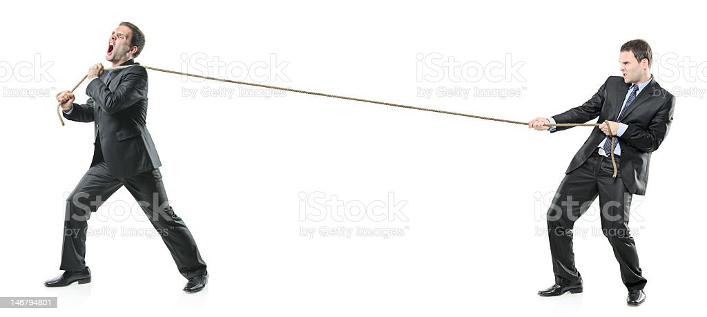 Two businessmen tugging on opposite sides of rope stock photo